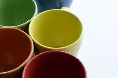 Brightly colored ceramic cups Royalty Free Stock Photo