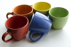 Brightly colored ceramic cups Stock Photo