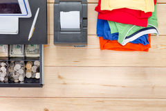 Brightly colored clothes and open cash register Royalty Free Stock Images