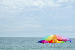 Brightly colored coloured beach umbrella Stock Photo