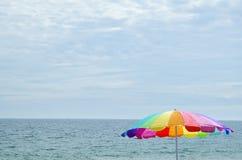 Brightly colored coloured beach umbrella stock photo
