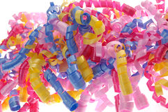 Brightly colored curly ribbon. Brighly colored curly ribbon in yellow, pnk and blue Royalty Free Stock Photos