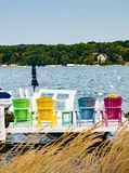 Brightly Colored Deck Chairs on Geneva Lake Stock Image