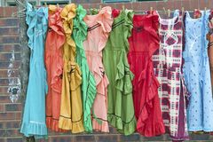 Brightly colored dresses on display in Zulu village in Zululand, South Africa Royalty Free Stock Image