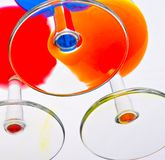 Brightly colored drinks. A bottom view of three glasses filled with brightly coloured drinks Stock Image
