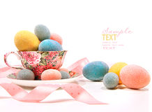 Brightly Colored Eggs In Tea Cup Royalty Free Stock Image