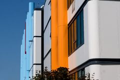 Colorful large pipes in blue and yellow provide interesting contrast to this university building. Brightly colored external pipes offer interesting design at royalty free stock photography