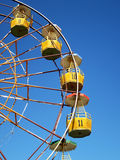 Brightly colored Ferris. Ferris wheel with numbers isolated on blue sky in background , Brightly colored Ferris wheel against the blue sky Stock Photography