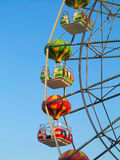 Brightly colored Ferris wheel against the blue sky Royalty Free Stock Photos