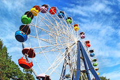 Brightly colored Ferris wheel against the sky Stock Photos