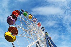 Brightly colored Ferris wheel against the sky Stock Photo