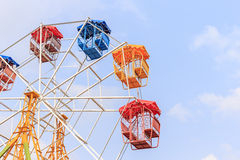 Brightly colored Ferris wheel on the blue sky Stock Photo