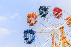 Brightly colored Ferris wheel on the blue sky Royalty Free Stock Photos