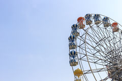 Brightly colored Ferris wheel on the blue sky Royalty Free Stock Images