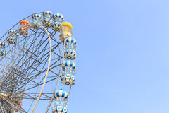 Brightly colored Ferris wheel on the blue sky Royalty Free Stock Image