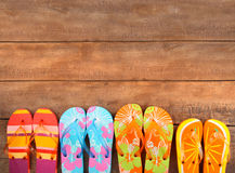 Free Brightly Colored Flip-flops On Wood Stock Photos - 14813173