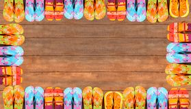 Brightly colored flip-flops on wood Royalty Free Stock Photo