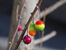 Brightly colored floats with hooks for fishing. The brightly colored floats with hooks for fishing Stock Image