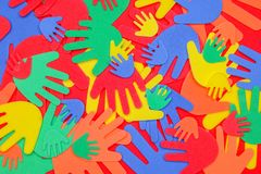 Brightly colored funky foam hands stock photo