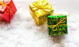 Brightly colored gift boxes on wooden background, top view, new year and Christmas. Bright shade Stock Photography