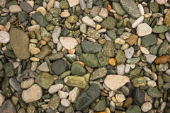 Brightly colored green stones at Illia beach, Evia, Greece Stock Photos