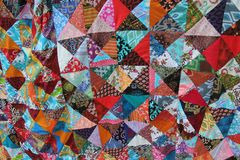 Brightly colored homemade patchwork with abstract patterns royalty free stock image