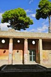 Brightly colored House Entrance, Herculaneum Campania, Italy. Ancient House with Pillars in Herculaneum. Portrait Mode. Herculaneum was buried in the eruption of Royalty Free Stock Photo