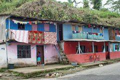 Brightly colored houses in the Ecuadorian jungle. Brightly painted houses with laundry hanging from the balconies in the jungle town of Alto Tambo, Ecuador Royalty Free Stock Photography