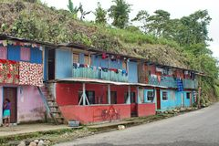 Brightly colored houses in the Ecuadorian jungle. Brightly painted houses with laundry hanging from the balconies in the jungle town of Alto Tambo, Ecuador Stock Images