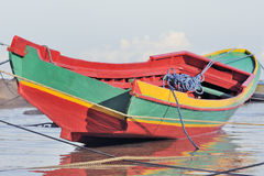 Brightly colored indonesian fishing boat Stock Photos