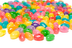 Brightly Colored Jelly Beans. Yummy brightly colored jelly beans on white background Royalty Free Stock Photos
