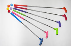 Brightly colored Mini Golf Clubs and Balls Stock Images