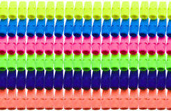 Brightly colored pencil erasers in rows. Photo-illustration of brightly colored yellow, blue, red, green, purple, and orange pencil erasers in rows Royalty Free Stock Images