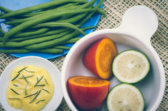 Brightly colored plate with green beans, butter Royalty Free Stock Photo