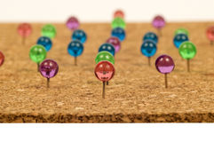 Brightly Colored Pushpins In Cork Stock Images