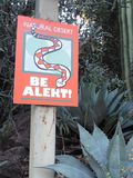 Brightly colored rattlesnake warning sign on a path in a desert park in Arizona. A Brightly colored rattlesnake warning sign on a trail in a desert park in stock images