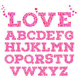 Brightly colored romantic alphabet with love inscription made of small vivid heart shapes in mosaic style. Brightly colored romantic alphabet with love Stock Photos