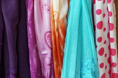 Brightly colored scarfs and veils Stock Images