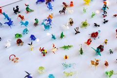 Brightly colored small glass ornaments of animals Royalty Free Stock Photography