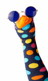 Brightly colored sock puppet with polk dots. Wearing trendy hipster round sunglasses isolated on white in a close up view of the cute orange face Stock Photography