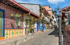 Brightly colored street in Guatape, Colombia. Guatape, Colombia- March 6, 2017: Brightly colored street in Guatape, Colombia Royalty Free Stock Photos