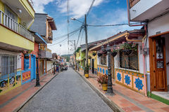 Brightly colored street in Guatape, Colombia. Guatape, Colombia- March 6, 2017: Brightly colored street in Guatape, Colombia Royalty Free Stock Photo