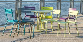 Brightly colored tables and chairs. At the Brooklyn bridge Promenade in New York City Royalty Free Stock Photos