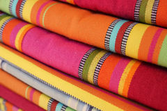 Brightly colored textiles in the market Stock Photos