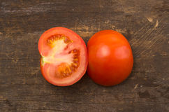 Brightly colored tomato cut in half with one side Royalty Free Stock Image