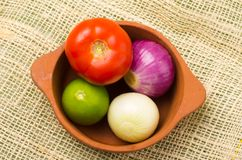 Brightly colored tomato, onions and lemon in Stock Image