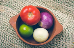 Brightly colored tomato, onions with lemon in Royalty Free Stock Photos