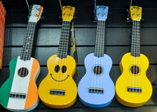 Brightly colored ukeleles in a gift shop in Ireland. Ukuleles, colorful, whimsical, happy, smiling, acoustic, Hawaiian, colors, instrument Royalty Free Stock Image