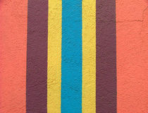 Brightly colored wall with vertical stripes Stock Images