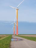 Brightly colored wind turbine in Dutch landscape Stock Photos